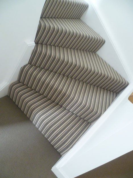 Striped staircase, plain landing contrast